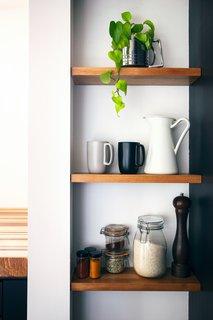Inset shelves made of oak keep supplies close at hand.