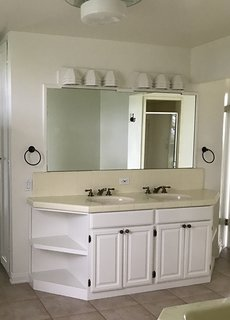 The Jack and Jill bathroom is located between two guest bedrooms and needed more oomph. According to Samuel, the old vanity jutted too far into the space and made for visual clutter.