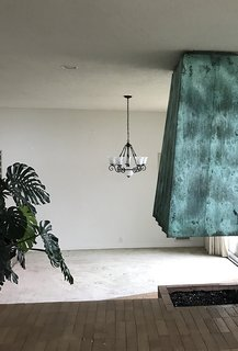 The dining room had lackluster carpeting and a run-of-the-mill chandelier.