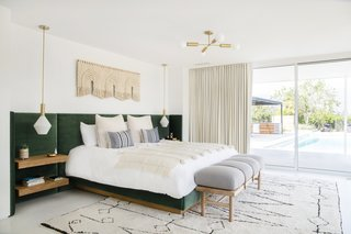 Samuel specified a custom velvet built-in headboard, then had it adorned with simple floating bedside shelves. Cedar & Moss lighting, the Safari Bench from Georgia-based Katy Skelton, and a custom weaving by Sally England finishes the cozy space.