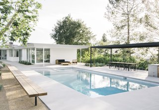 """For the landscape and redesigned pool area, Terremoto kept """"their movies simple and elemental,"""" matching the subtractive approach taken in the house. The firm collaborated with Farnham on the design of the long-span pergola, which is cleverly engineered to only need four support posts."""