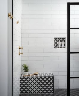 The patterned tile on the built-in shower bench is from Kerion Ceramics, and is playfully repeated in the wall niche.