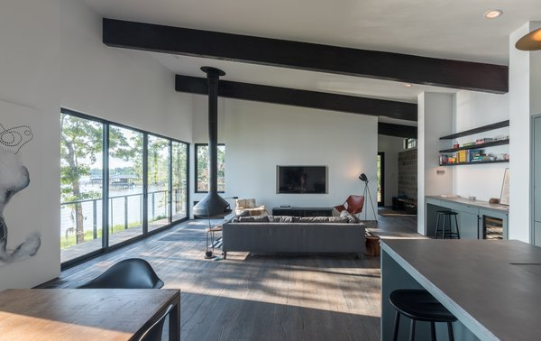 Hanging Fireplace and Living Room  Lakefront by studioMET architects