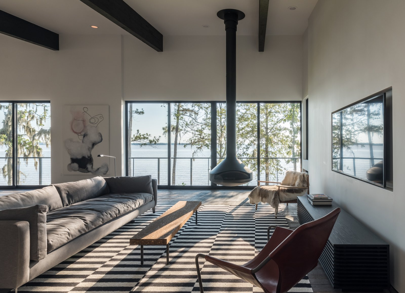 Living Room and Hanging Fireplace  Lakefront by studioMET architects
