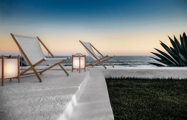 Inspired by the campaign furniture from the colonial era, the Voyager deck chair and Ambient lantern evoke a contemporary look with a vintage allure.