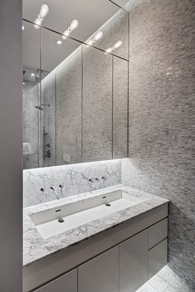 Upper Level: Master Bathroom.                                                                                                                                      The lighting scheme was designed to enhance the spatial qualities.