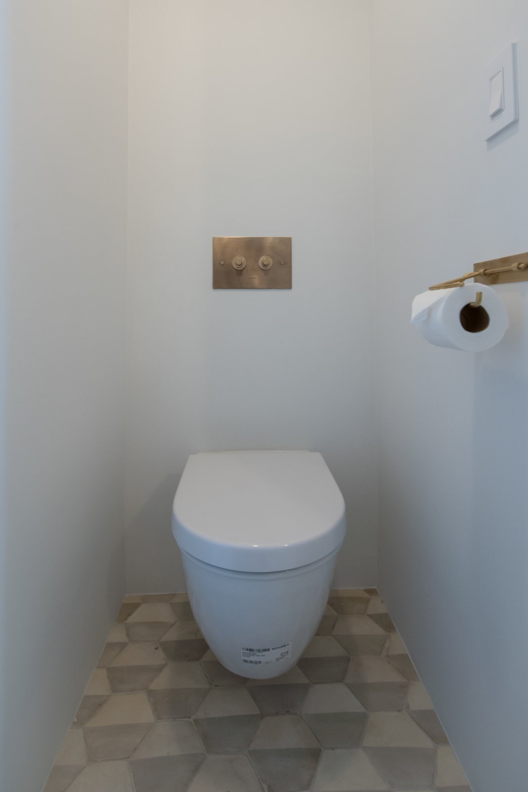 Tagged: Marble Counter, Stone Slab Backsplashe, Stone Counter, White Cabinet, Wood Cabinet, Front Yard, Accent Lighting, Ceiling Lighting, Undermount Sink, and Bath Room.  The Oaks on Whitman