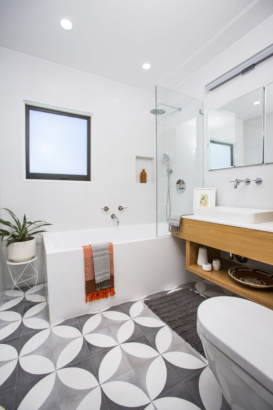 Bath Room, Concrete Floor, Engineered Quartz Counter, Corner Shower, Vessel Sink, Wall Lighting, Recessed Lighting, Ceramic Tile Wall, Ceiling Lighting, Soaking Tub, and One Piece Toilet  Silverlake on Riverside Terrace