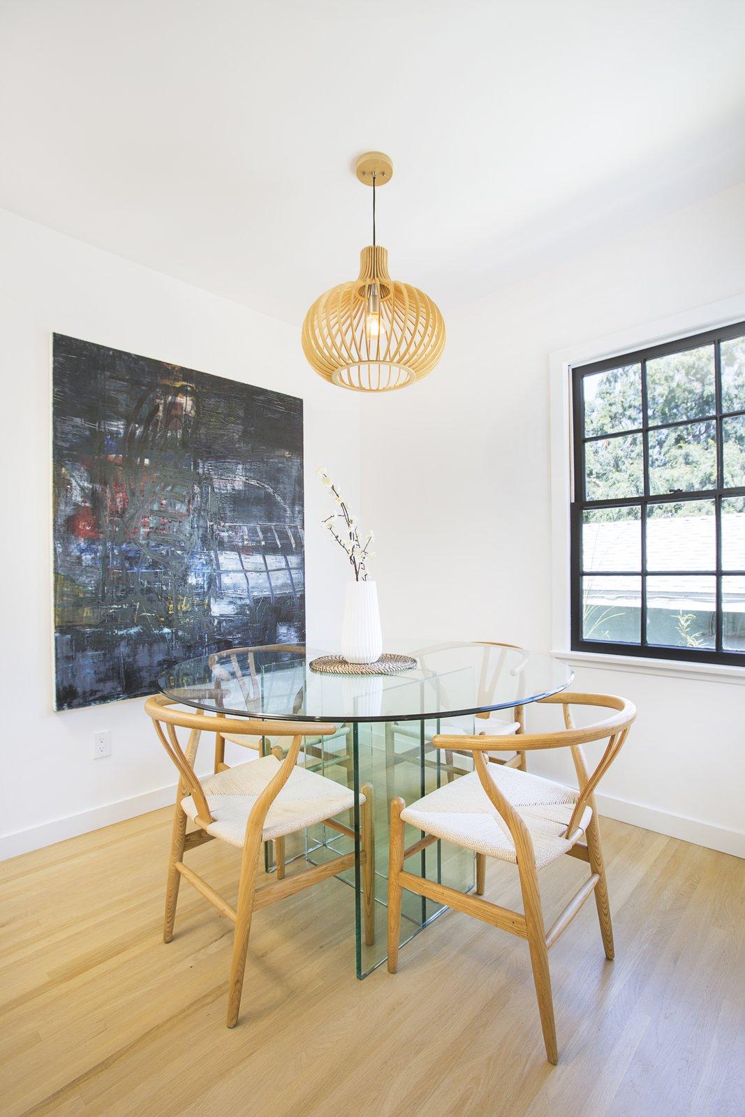 Dining Room, Ceiling Lighting, Table, Chair, and Light Hardwood Floor  Silverlake on Riverside Terrace