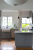 Modern home with Kitchen, Engineered Quartz Counter, Wood Cabinet, Ceiling Lighting, Light Hardwood Floor, Recessed Lighting, and Stone Tile Backsplashe. Photo 2 of SilverLake Kitchen Update