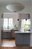 Modern home with Kitchen, Engineered Quartz Counter, Ceiling Lighting, Recessed Lighting, Wood Cabinet, Light Hardwood Floor, and Stone Tile Backsplashe. Photo 3 of SilverLake Kitchen Update