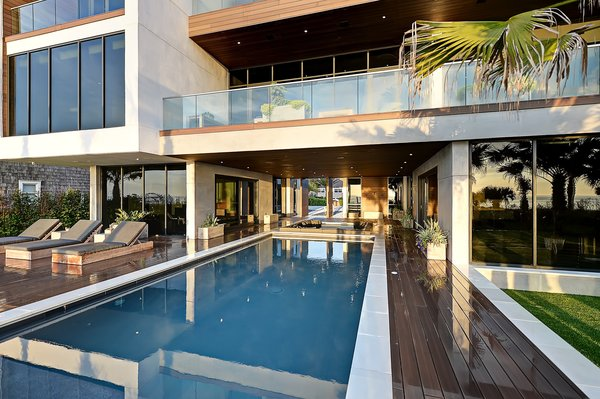 Covered deck, sunken fire pit, and pool