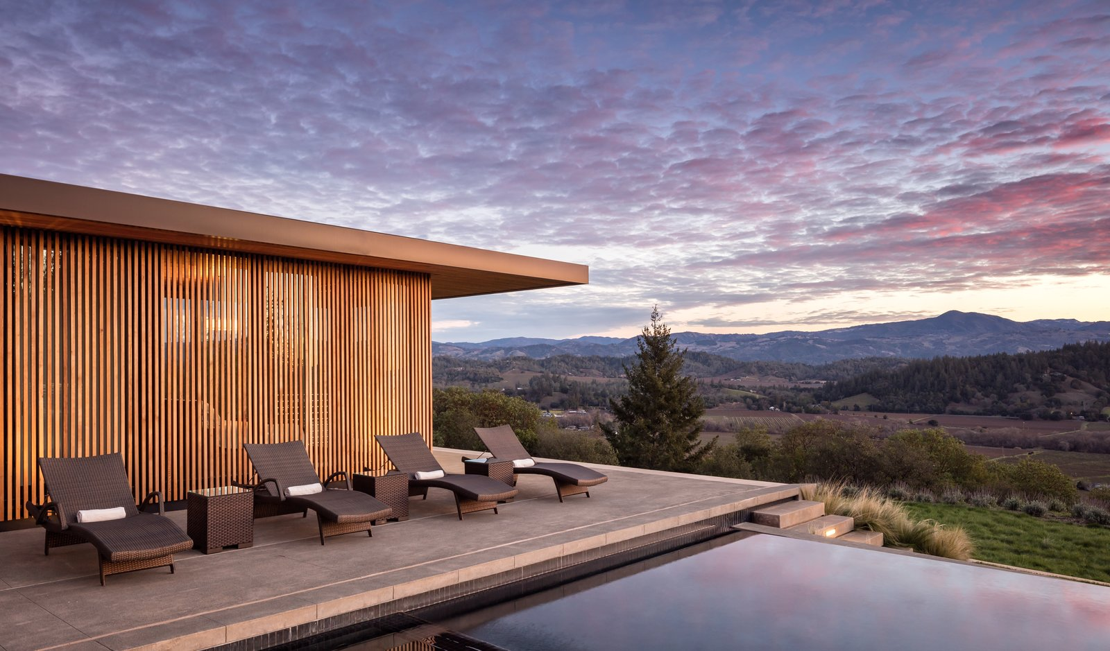 Outdoor, Slope, Back Yard, Field, Trees, Grass, Flowers, Shrubs, Concrete Patio, Porch, Deck, Swimming Pools, Tubs, Shower, and Infinity Pools, Tubs, Shower  Dry Creek by John Maniscalco Architecture