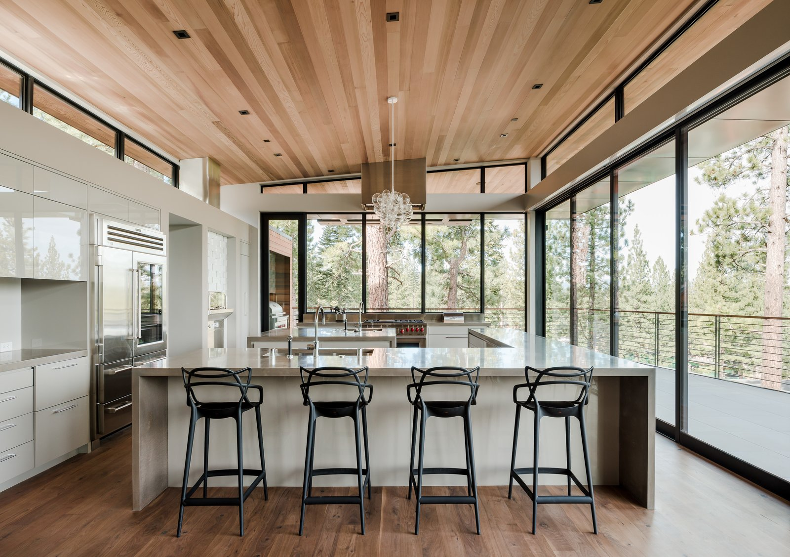 Kitchen, Engineered Quartz Counter, White Cabinet, Medium Hardwood Floor, Ceiling Lighting, Recessed Lighting, Refrigerator, Accent Lighting, Wall Oven, Range, and Undermount Sink  Martis Camp Residence 2 by John Maniscalco Architecture