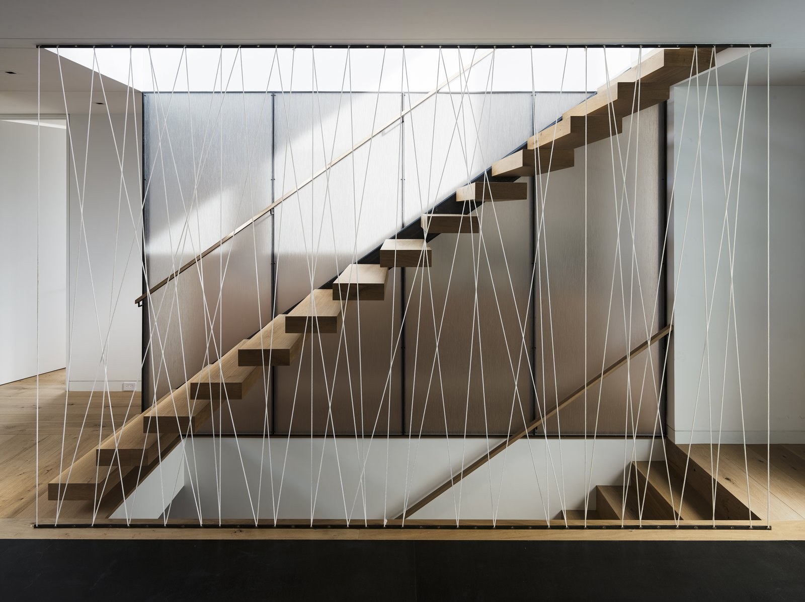 Wood Tread, Cable Railing, and Staircase  Spruce by John Maniscalco Architecture
