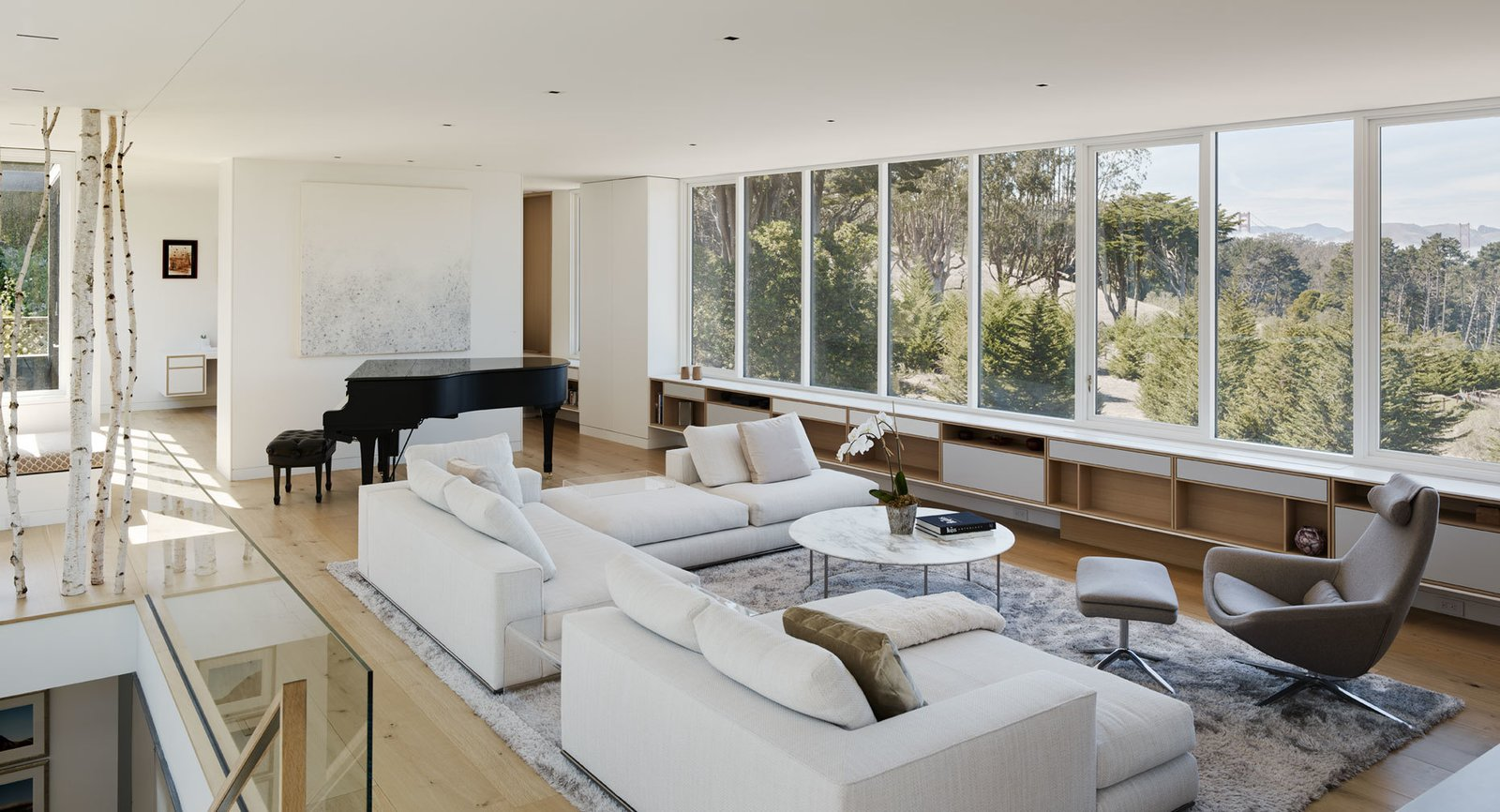 Living Room, Chair, Table, Bookcase, Storage, Sectional, Shelves, Recessed Lighting, Ceiling Lighting, and Light Hardwood Floor  Spruce by John Maniscalco Architecture