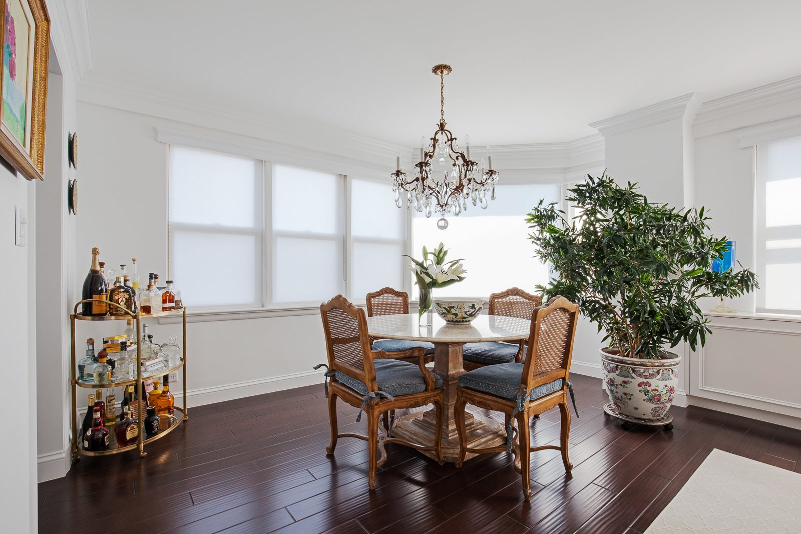 Dining Room and Dark Hardwood Floor  AN ART-FILLED APARTMENT RENOVATION 40 YEARS IN THE MAKING! by Pixy Interiors
