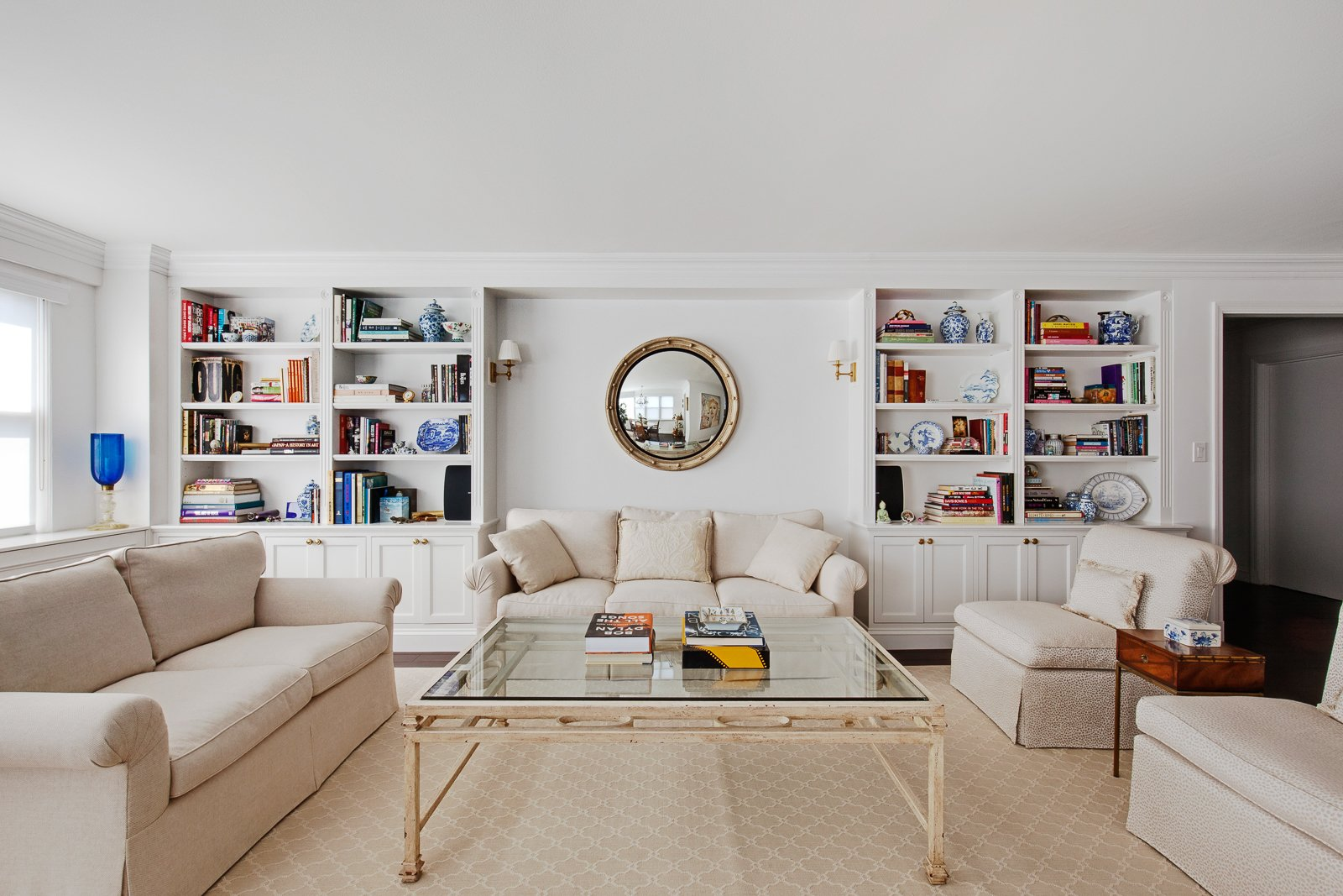 Living Room, Bookcase, Sofa, Coffee Tables, and Chair  AN ART-FILLED APARTMENT RENOVATION 40 YEARS IN THE MAKING! by Pixy Interiors