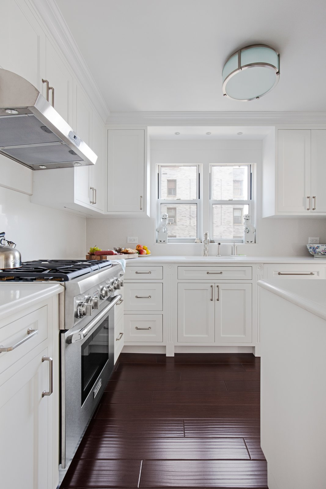 Kitchen, White Cabinet, and Dark Hardwood Floor  AN ART-FILLED APARTMENT RENOVATION 40 YEARS IN THE MAKING! by Pixy Interiors