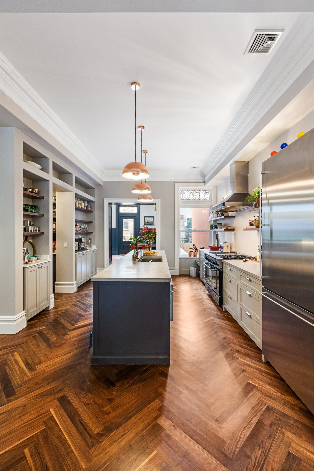 Kitchen and Medium Hardwood Floor  A LONG TOWNHOUSE SETS THE RIGHT FLOW FOR MODERN LIVING (PART 2, SWEETEN project) by Photo by Pixy