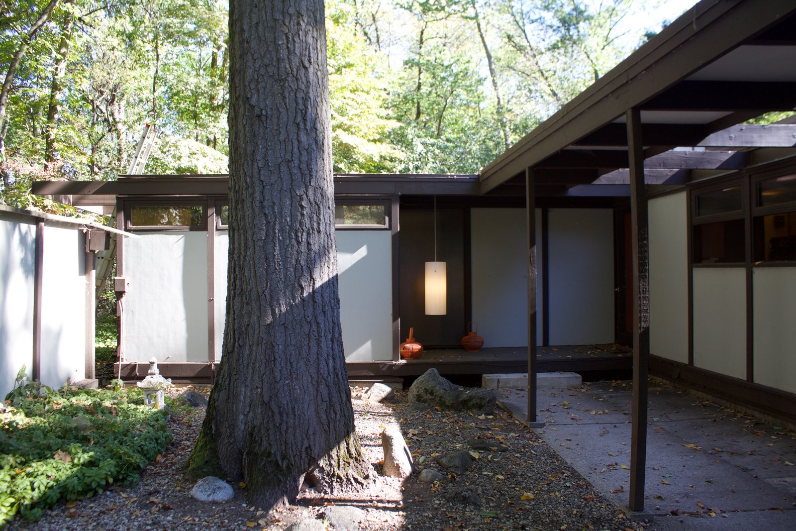 Exterior, House Building Type, Mid-Century Building Type, Concrete Siding Material, and Flat RoofLine Entry  Kalamazoo Post and Beam Restoration by Trystcraft