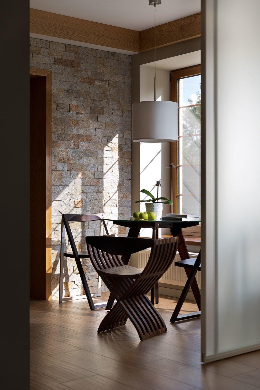 Kitchen, Stone Tile Backsplashe, Medium Hardwood Floor, Pendant Lighting, and Wood Cabinet  House Lightray