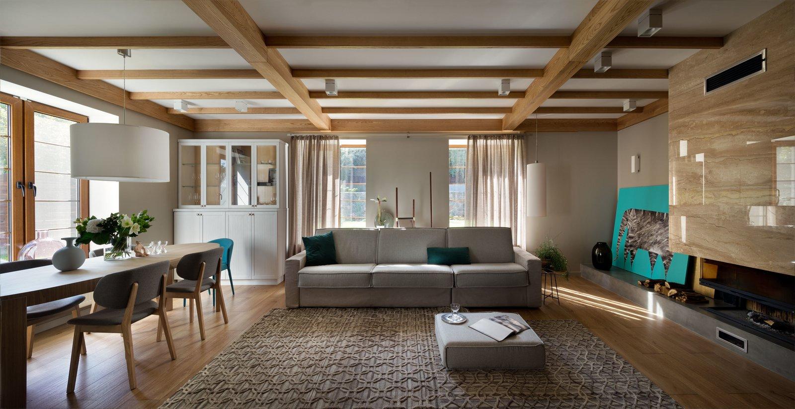 Living Room, Sofa, Coffee Tables, Wall Lighting, Pendant Lighting, and Medium Hardwood Floor  House Lightray