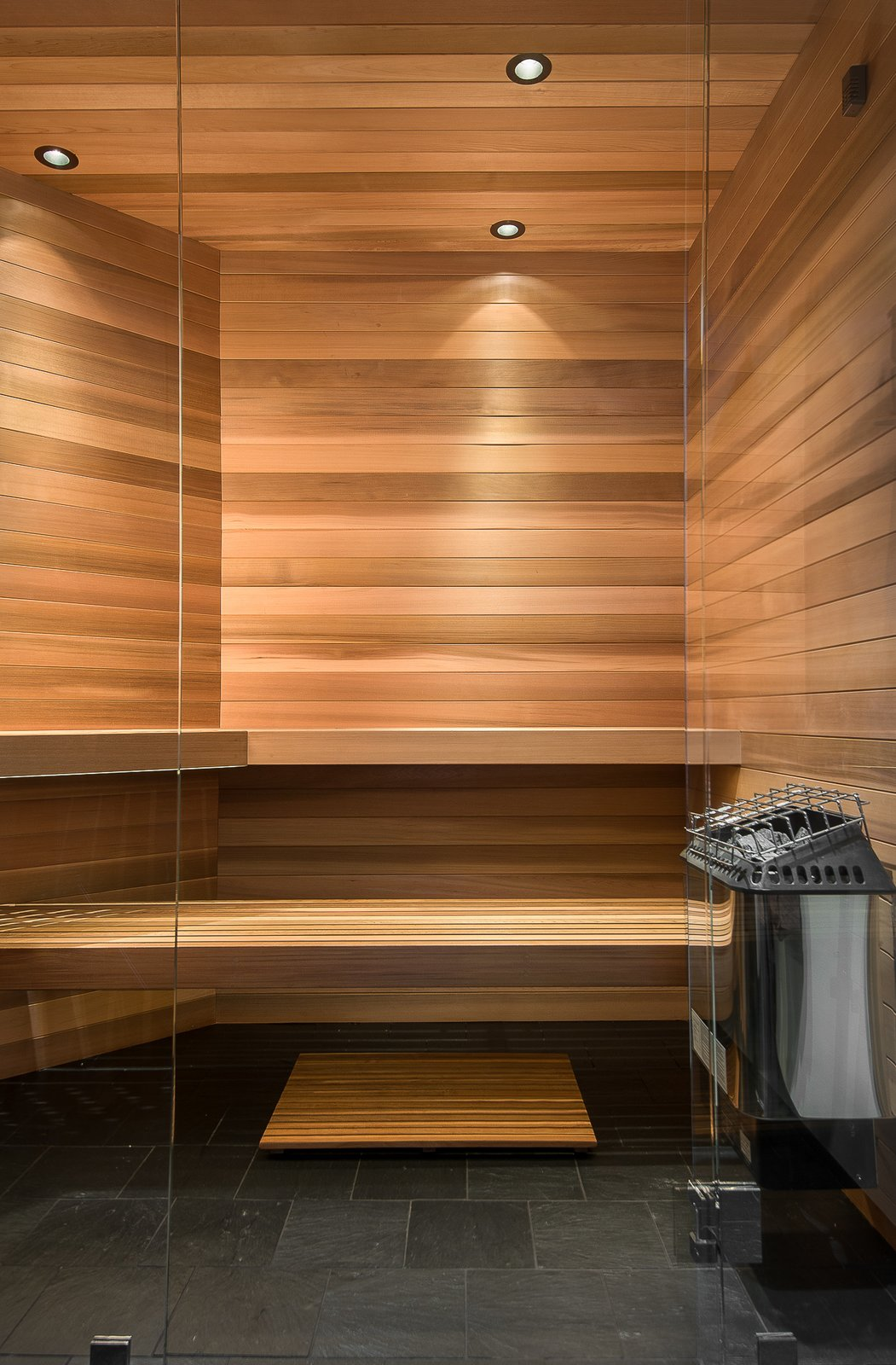 Bath Room, Slate Floor, and Ceiling Lighting Sauna  House in the Woods by Kim Smith
