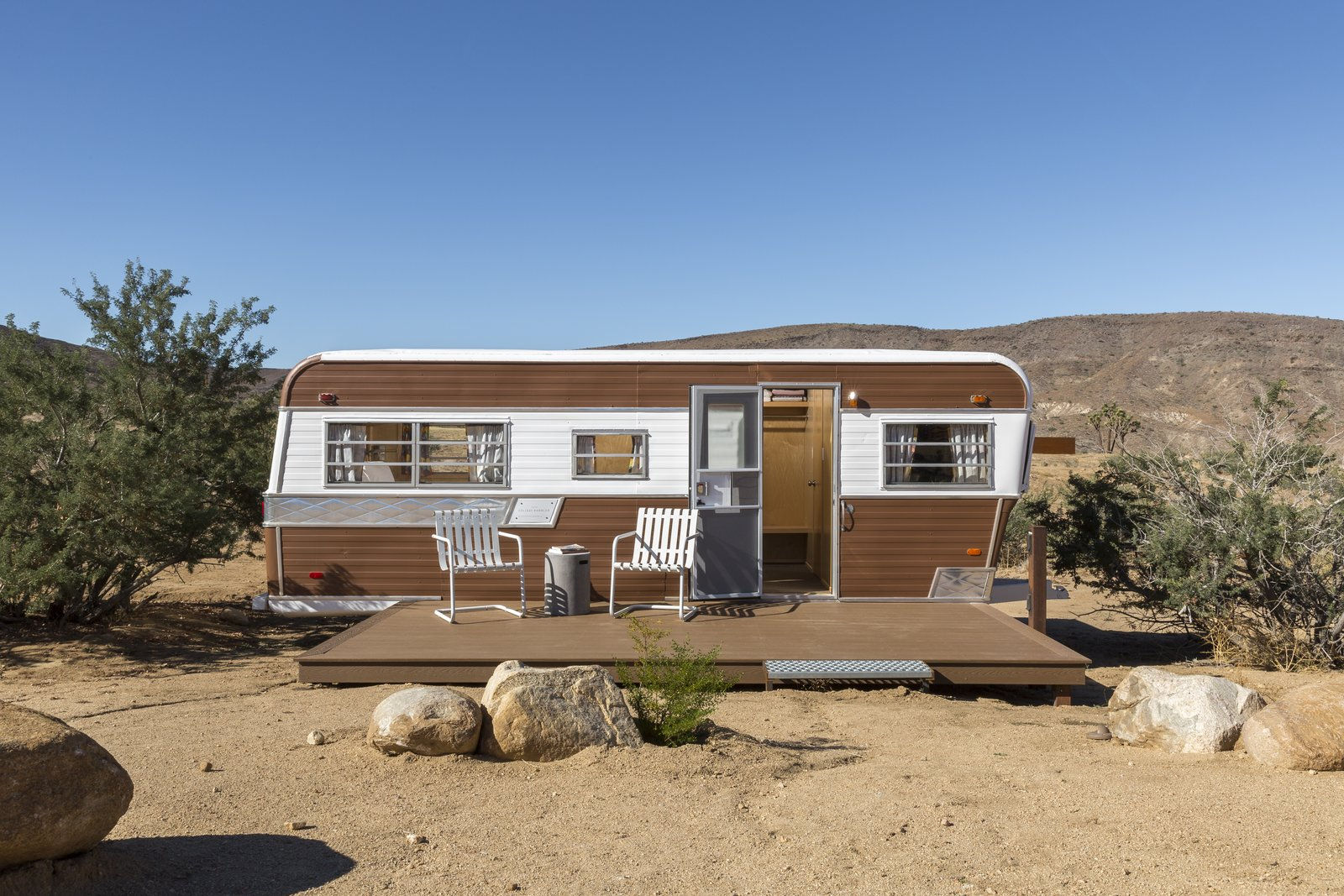 Exterior, Camper Building Type, Curved RoofLine, Metal Siding Material, and Metal Roof Material Revamped 1973 Holiday Rambler is now an all new living space.  Photo 8 of 10 in This Modern Homestead With a Vintage Trailer Offers Adventure in California's High Desert