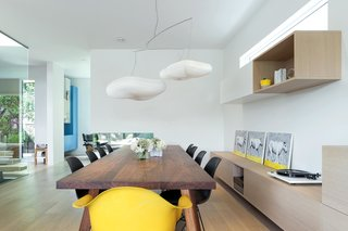 The dining area features a custom table and millwork by Christian Woo.
