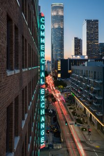 A 1920s Office Building Is Revamped as a Craftsman-Inspired Hotel in Los Angeles - Photo 3 of 10 - The 12-story Commercial Exchange sign, the largest in Los Angeles, still hangs proudly at the hotel's entrance.