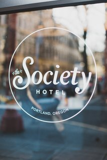 A Chic Portland Hotel Offers Lodging As Affordable as $35 a Night - Photo 1 of 10 - Window graphics provide unobtrusive and elegant signage on the exterior glazing of the historic facade.
