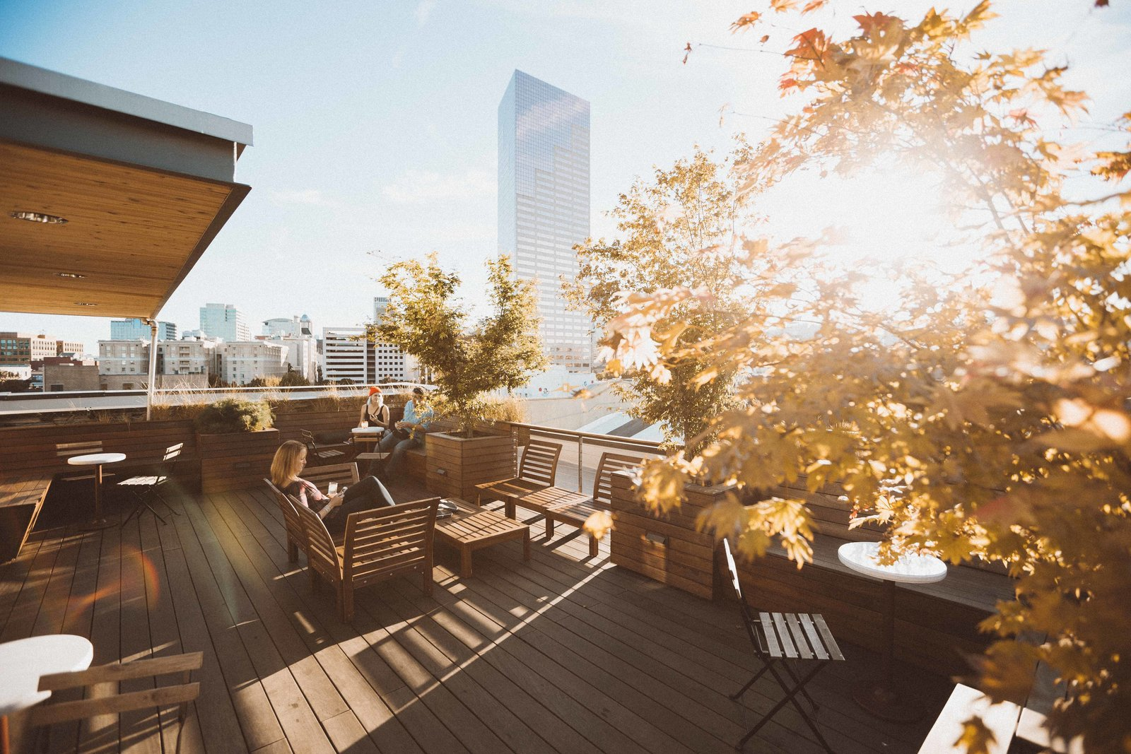 Outdoor, Rooftop, Trees, Wood Patio, Porch, Deck, and Raised Planters The rooftop terrace provides panoramic views to the surrounding neighborhood and city beyond.  Photo 10 of 11 in A Chic Portland Hotel Offers Lodging As Affordable as $35 a Night