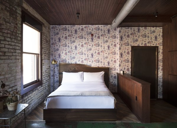 Bedroom, Bed, Floor Lighting, Concrete Floor, Ceiling Lighting, and Dark Hardwood Floor  Photo 4 of 11 in History and Modernity Meet in This Industrial Hotel and Restaurant in Philadelphia