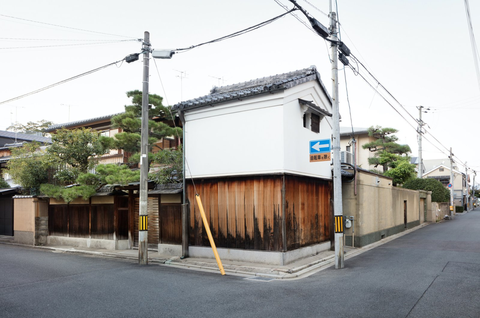 Exterior, Wood Siding Material, House Building Type, Gable RoofLine, Stucco Siding Material, and Tile Roof Material  Japanese Architec from A Minimalist Townhouse Provides Serene Accommodations in Historic Kyoto