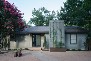 Bringing Light Into a Modest 1940s Bungalow in Austin - Photo 2 of 10 - The front elevation of the home remains modest in appearance with a simple vertical addition, maintaining the typical Austin bungalow aesthetic.