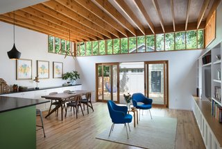 Bringing Light Into a Modest 1940s Bungalow in Austin - Photo 6 of 10 - No.1 Douglas Fir adds warmth to the space.  Custom clerestory lighting that wraps the interior allows light to fall deeper into the room.  Large, sliding glass doors connect the interiors to the outdoor deck.