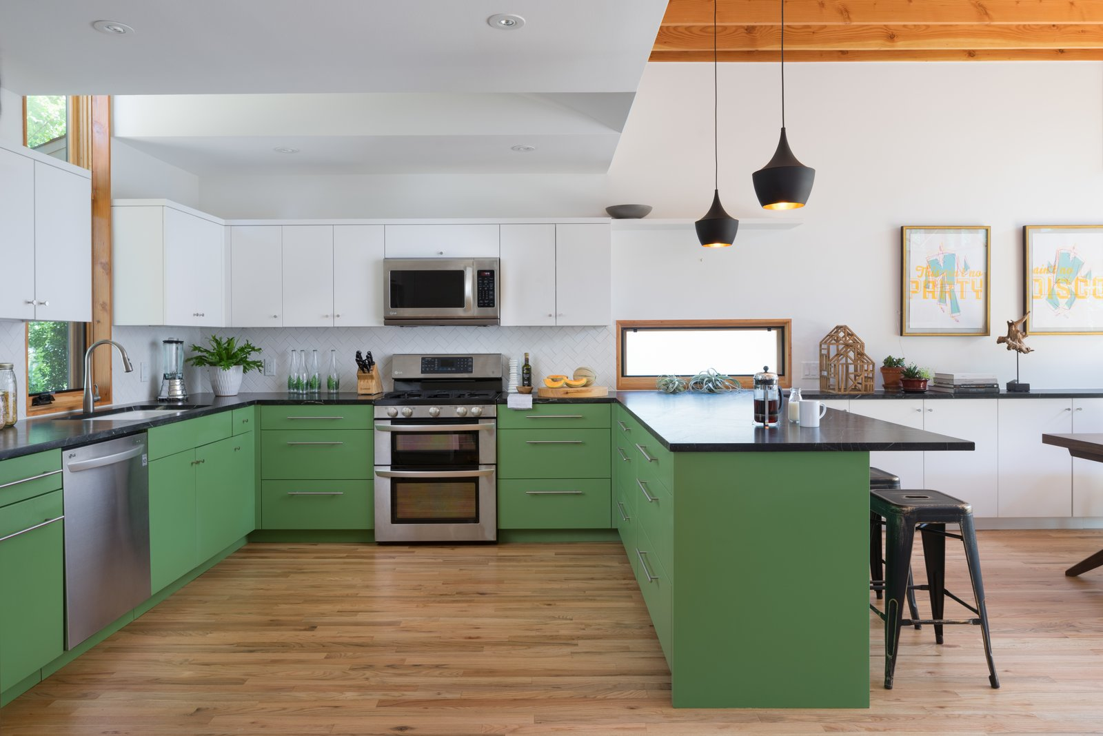 Kitchen, Subway Tile, Colorful, Accent, Medium Hardwood, Pendant, Microwave, Dishwasher, Range, and Undermount  Best Kitchen Range Subway Tile Microwave Photos from Bringing Light Into a Modest 1940s Bungalow in Austin