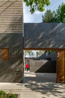Delightful Material Contrasts Define a Courtyard Home in Mexico City - Photo 2 of 10 -