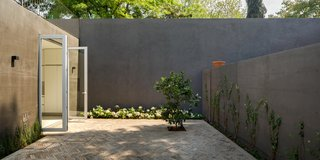 Delightful Material Contrasts Define a Courtyard Home in Mexico City - Photo 8 of 10 -