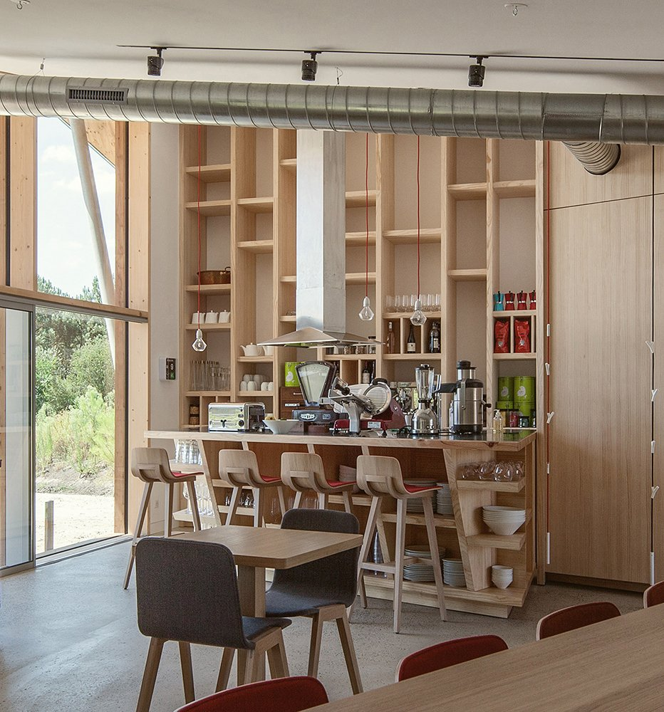 Dining, Chair, Stools, Bar, Shelves, Storage, Pendant, Track, Table, and Concrete  Best Dining Shelves Table Bar Stools Storage Chair Photos from Harmonizing With Nature, These Eco-Huts Offer Respite in the Heart of France