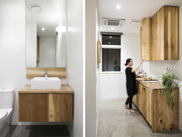 White oak cabinetry was custom built and fabricated by FWD.  Polished concrete floors and white tile compliment the warm wood tones.