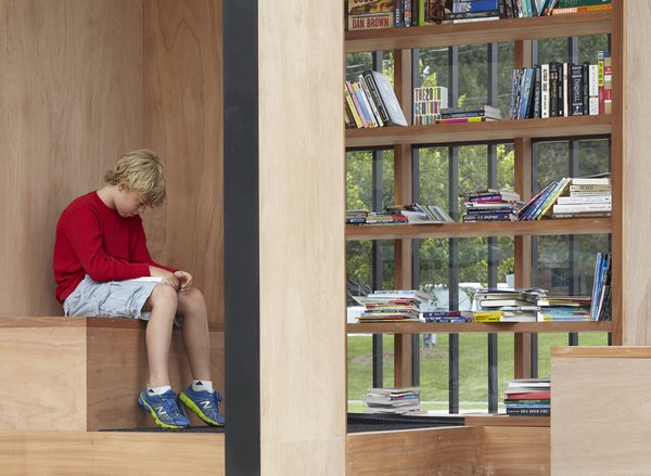 Guests are invited to bring and take books, or lounge on the built-in seating while reading.