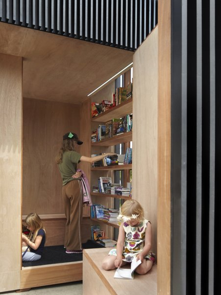 Wrapped in marine grade veneer plywood, the interior walls frame a warm oasis for reading and viewing.