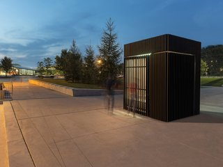 Toronto's Story Pod Doubles as a Lending Library and Community Hub - Photo 7 of 7 - Light shines through the slatted wall, providing illumination for nighttime gatherings and events.