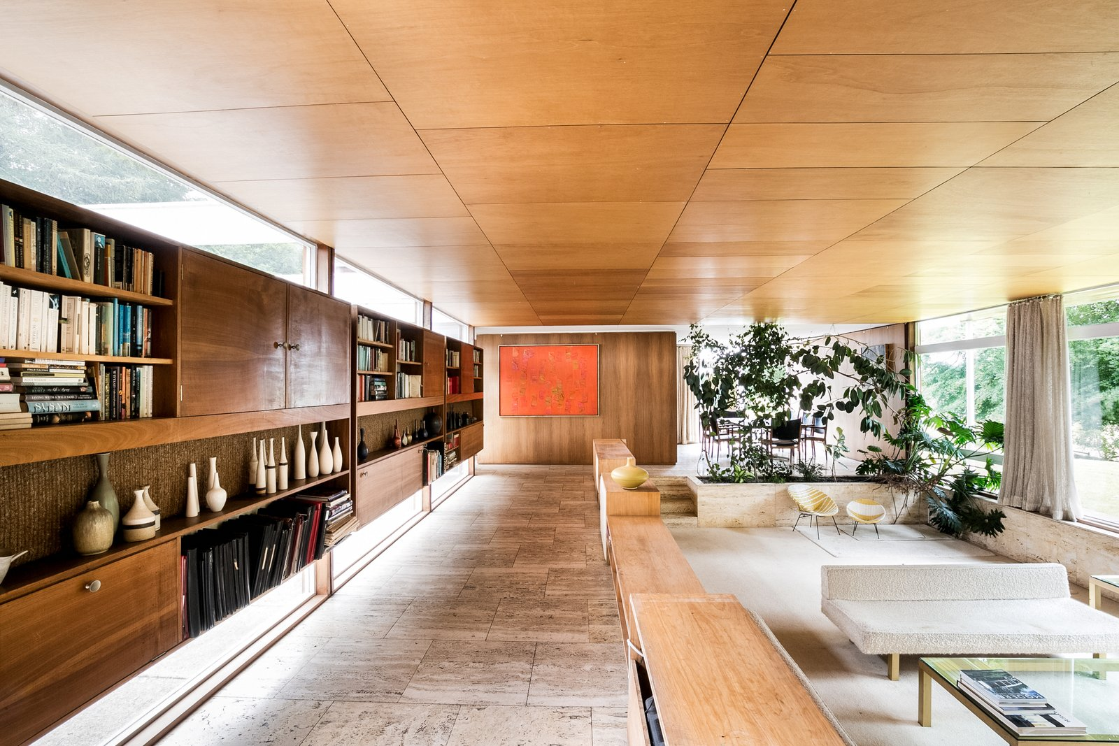 Living Room, Sofa, Chair, Coffee Tables, Storage, Shelves, and Travertine Floor  Photo 4 of 11 in The Iconic, Midcentury Home That Peter Womersley Designed For Bernat Klein Asks $1.02M