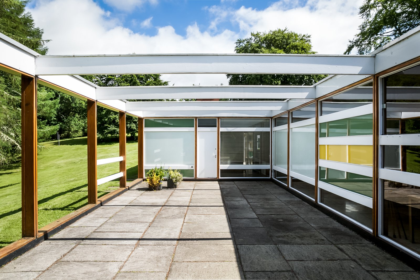 House, Wood, Metal, Concrete, Outdoor, Trees, Grass, Side Yard, Concrete, and Hardscapes  Best Outdoor House Side Yard Photos from The Iconic, Midcentury Home That Peter Womersley Designed For Bernat Klein Asks $1.02M