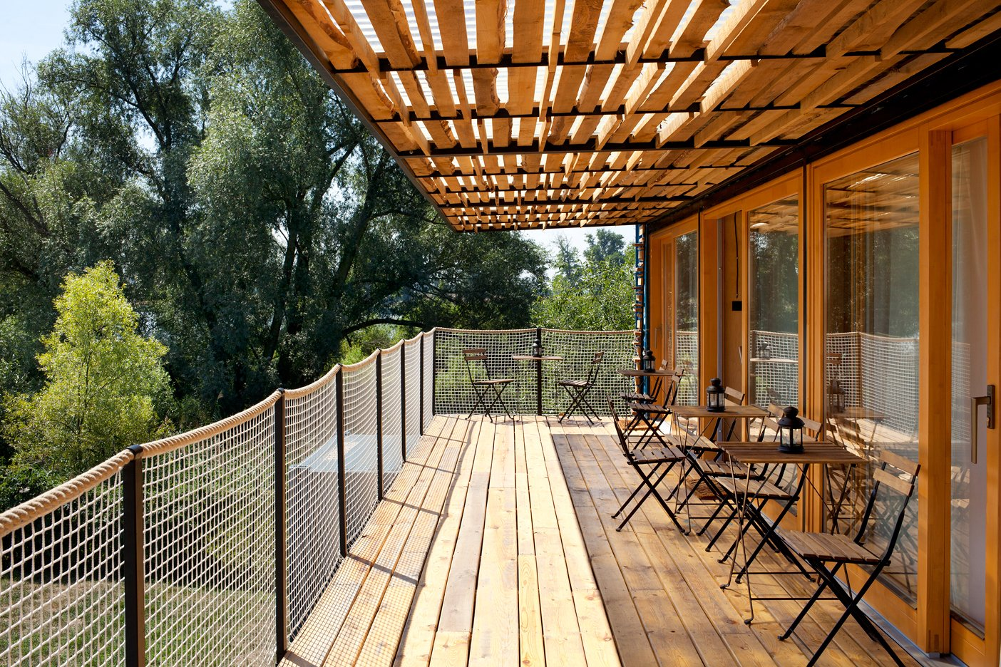 Outdoor, Rooftop, Trees, and Wood Patio, Porch, Deck  Photo 6 of 15 in A Mobile Boutique Hotel For the Modern Traveler Made From Shipping Containers