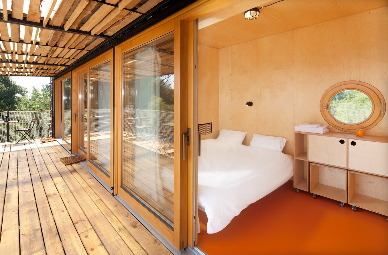 Bedroom, Bed, Night Stands, Storage, Ceiling Lighting, and Linoleum Floor  Photo 7 of 15 in A Mobile Boutique Hotel For the Modern Traveler Made From Shipping Containers