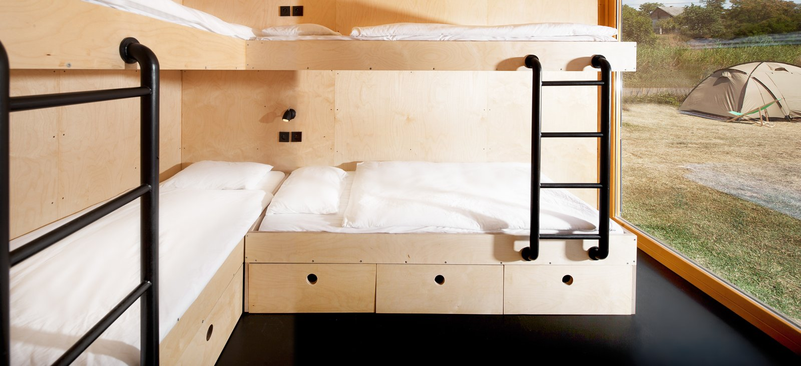 Bedroom, Bunks, Storage, and Linoleum Floor  Photo 10 of 15 in A Mobile Boutique Hotel For the Modern Traveler Made From Shipping Containers